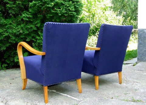 Royal blue velvet upholstered armchairs.
