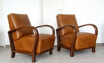 Art Deco leather armchairs.