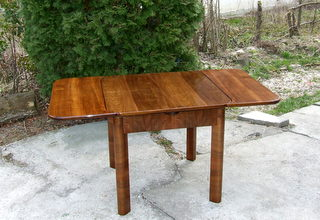 Extendable art deco dining table. Click here for more details.