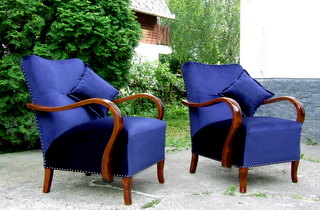 Art Deco armchairs. Royal blue upholstery and walnut arms.